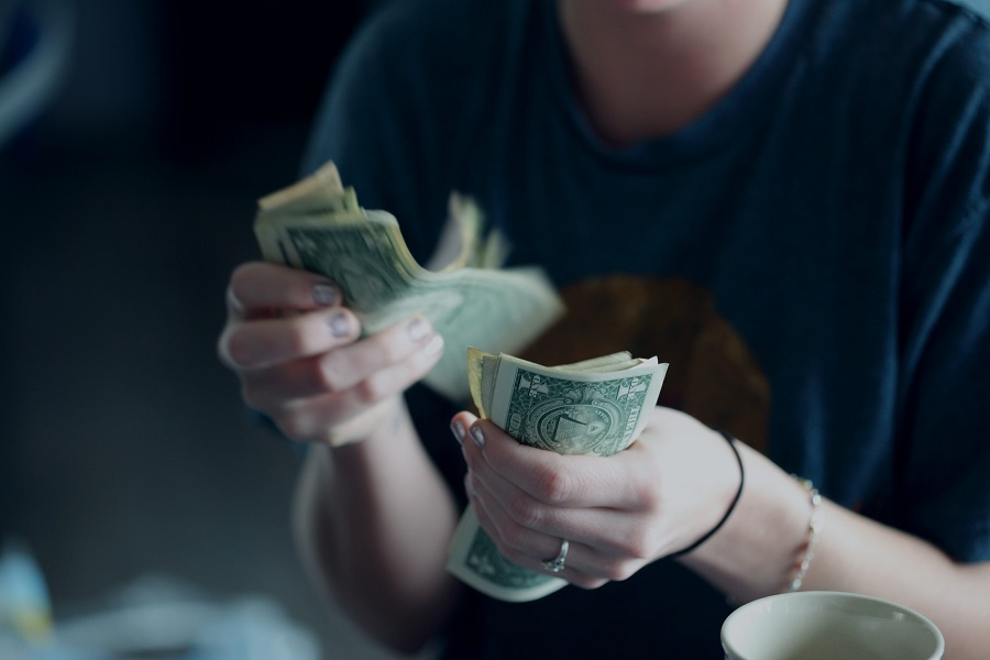 lady counting money to save