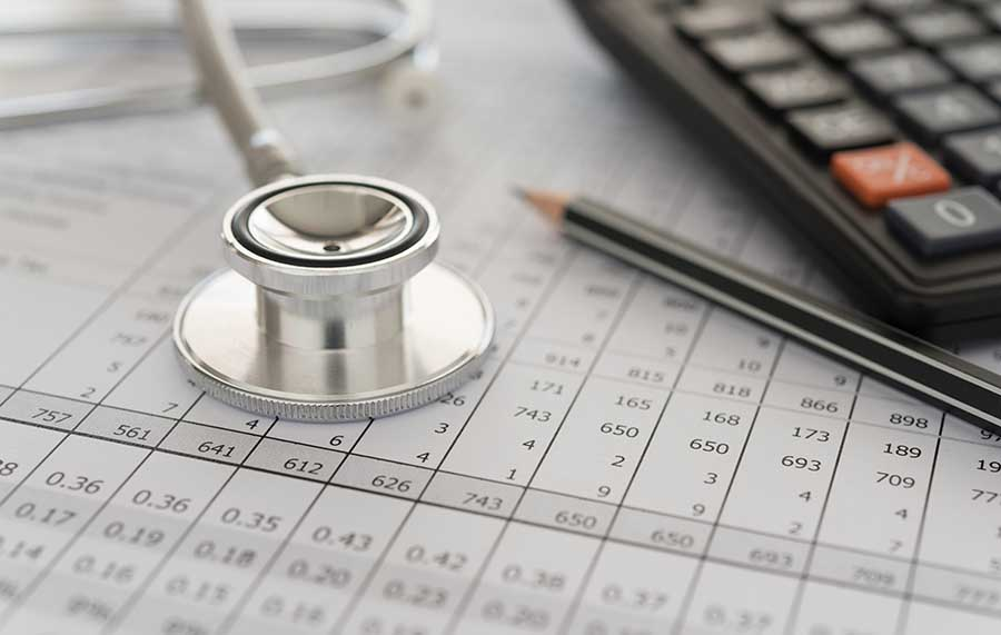 medical loan concept with stethoscope on top of forms