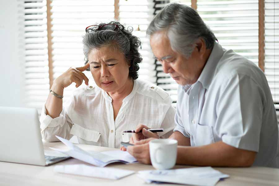 elderly couple deciding between secured and unsecured loan