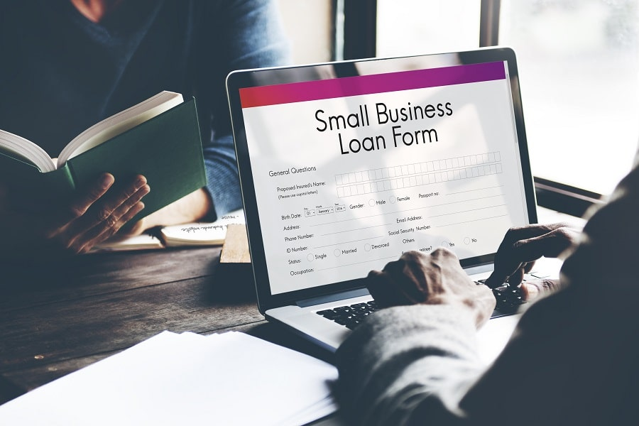 A person filling up business loan form
