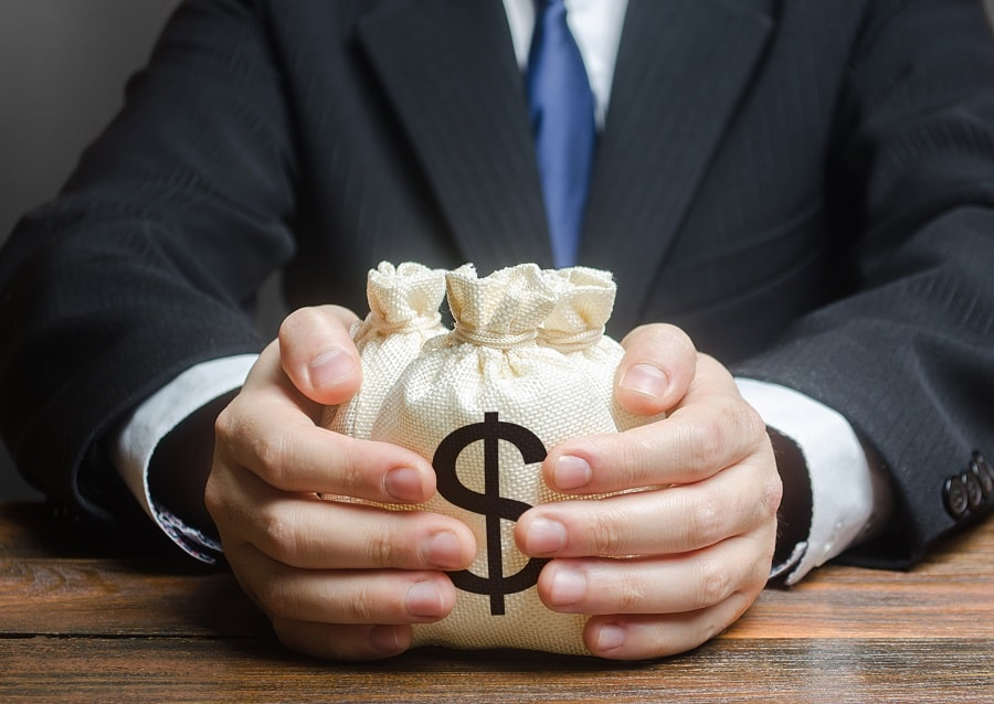 a man holding a money bag from a private loan