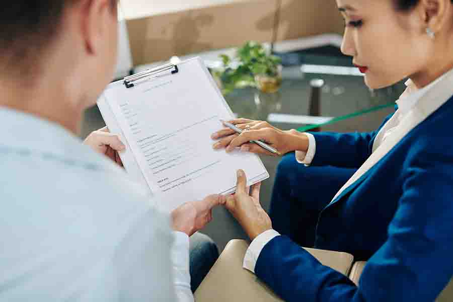 licensed moneylender presenting contract to customer