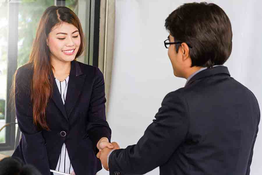 lady shaking hands after repaying her full loan